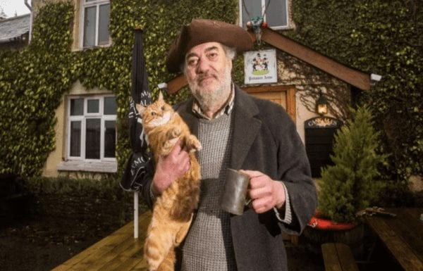 """Steve Cotten (AKA 'Britain's Grumpiest Landlord') – The Politmore Arms, Yarde Down, South Molton, Devon, EX36 3HA – Alongside a cat named 'Frederick Albert Hitler' as barman, landlord of the """"maddest pub in Britain"""" Steve Cotten is certainly eccentric."""