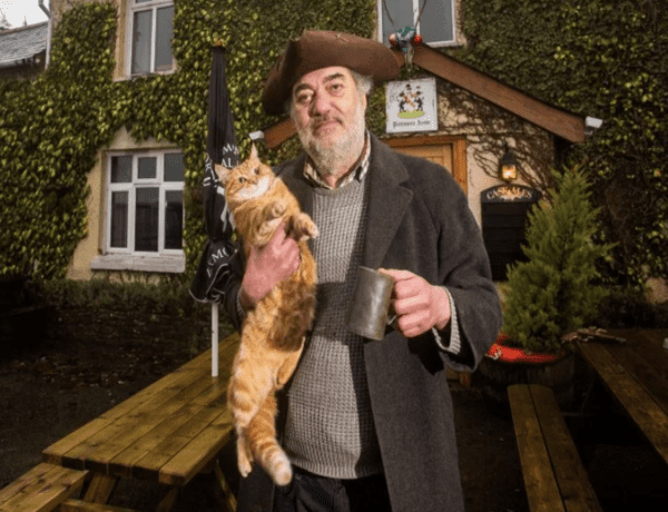 "Steve Cotten (AKA 'Britain's Grumpiest Landlord') – The Politmore Arms, Yarde Down, South Molton, Devon, EX36 3HA – Alongside a cat named 'Frederick Albert Hitler' as barman, landlord of the ""maddest pub in Britain"" Steve Cotten is certainly eccentric."