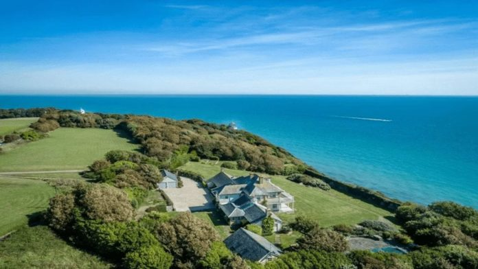 Back on The Front – £5 million for The Cliff House, The South Foreland Estate, The Front, St Margaret's Bay, Dover, Kent, CT15 6HP, United Kingdom through estate agents Knight Frank – Coastal 'estate' with its own lighthouse perched on the White Cliffs of Dover for sale; it was used in scenes featuring Oliver Reed in 'The Shuttered Room.'