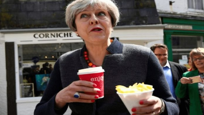 Theresa The Tea Leaf – Theresa May accused of being a tea leaf – Tea leaf Theresa May lookalike goes on the rampage in Hereford and robs a purse; at least she didn't grab 'The Donald's' hand.