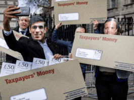 "Picture of the Week – Cesspit Street – Protestors brandishing envelopes of 'taxpayers' money' sum up the state of Boris Johnson's rotten government as ex-minister Johnny Mercer quite rightly brands it a ""cesspit"""